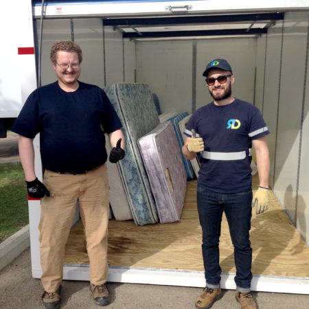 Evergreen Recycling's mattress recycling team in Edmonton collect mattress items from the U of A Eco Move Out.